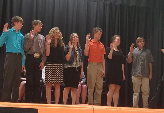 Photo by Candi Lynn,  The 2017 Inductees being inducted into the National Honor Society. Pictured (left to right): Kaleb Darrow, Chance Grill, Maddie Peterson, Callie Printz, Dalton Reutter, Abigail Tidball, Dylan Urban.